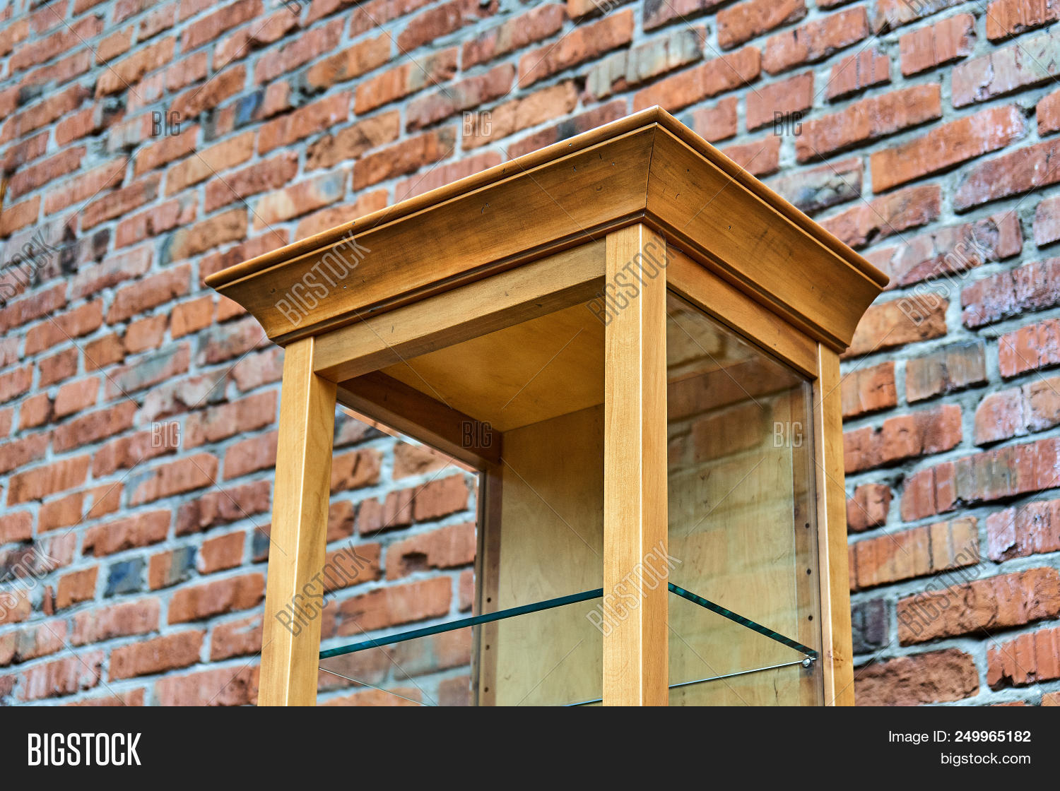 � Wooden Shelving With Empty Glass Shelves Old Brick
