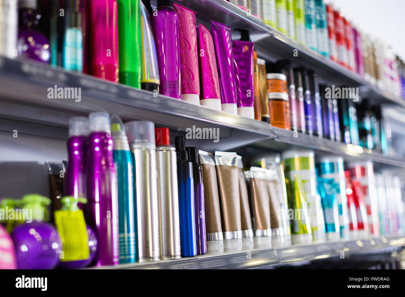 Shelves With Fashionable Hair Care Products In A Cosmetics