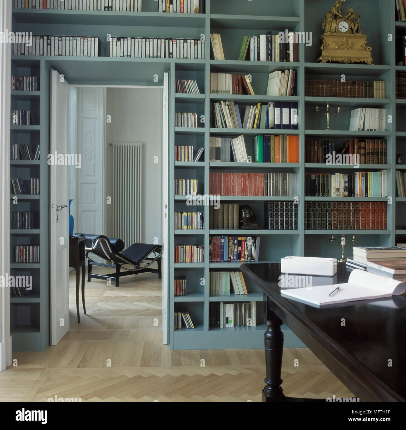 Home Library With Book Shelves Covering Walls Stock Photo
