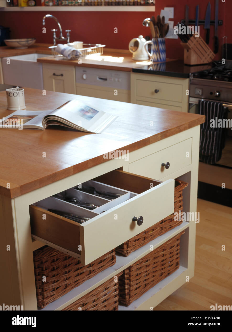 Open Drawer Above Storage Baskets On Shelves In Island
