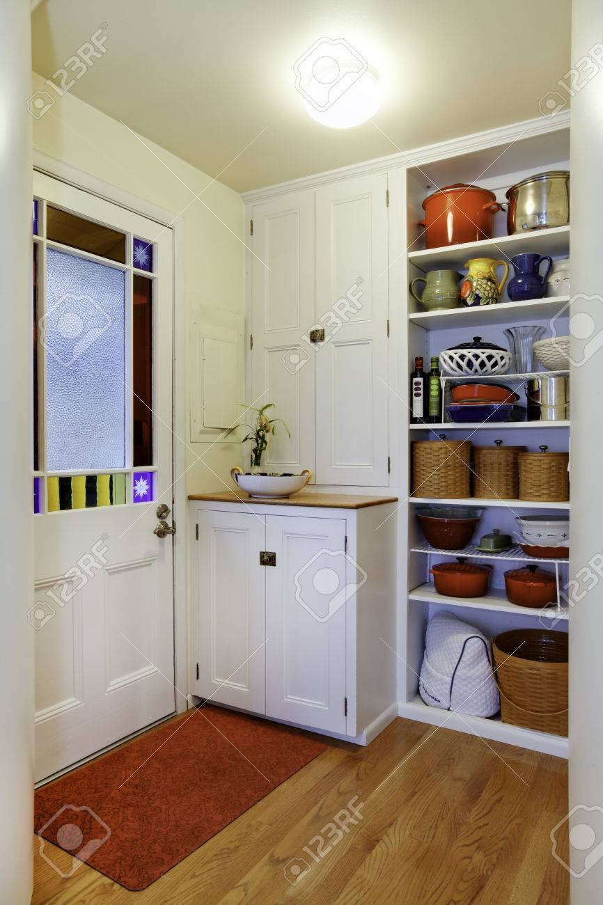 Pantry View With Storage Shelves In Small Hallway Exit To Backyard