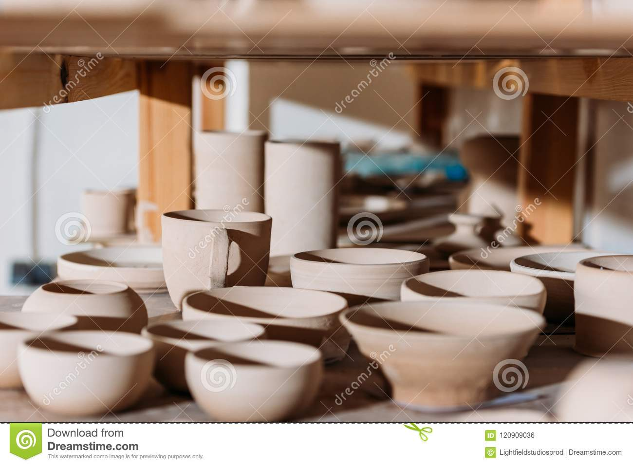 Ceramic Cups And Bowls On Wooden Shelves Stock Photo - Image